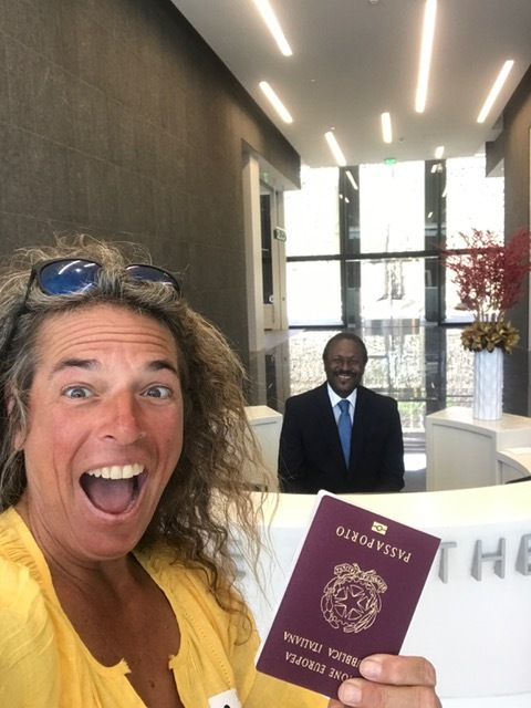 Our client Maureen was so excited she forgot to turn her passport around!